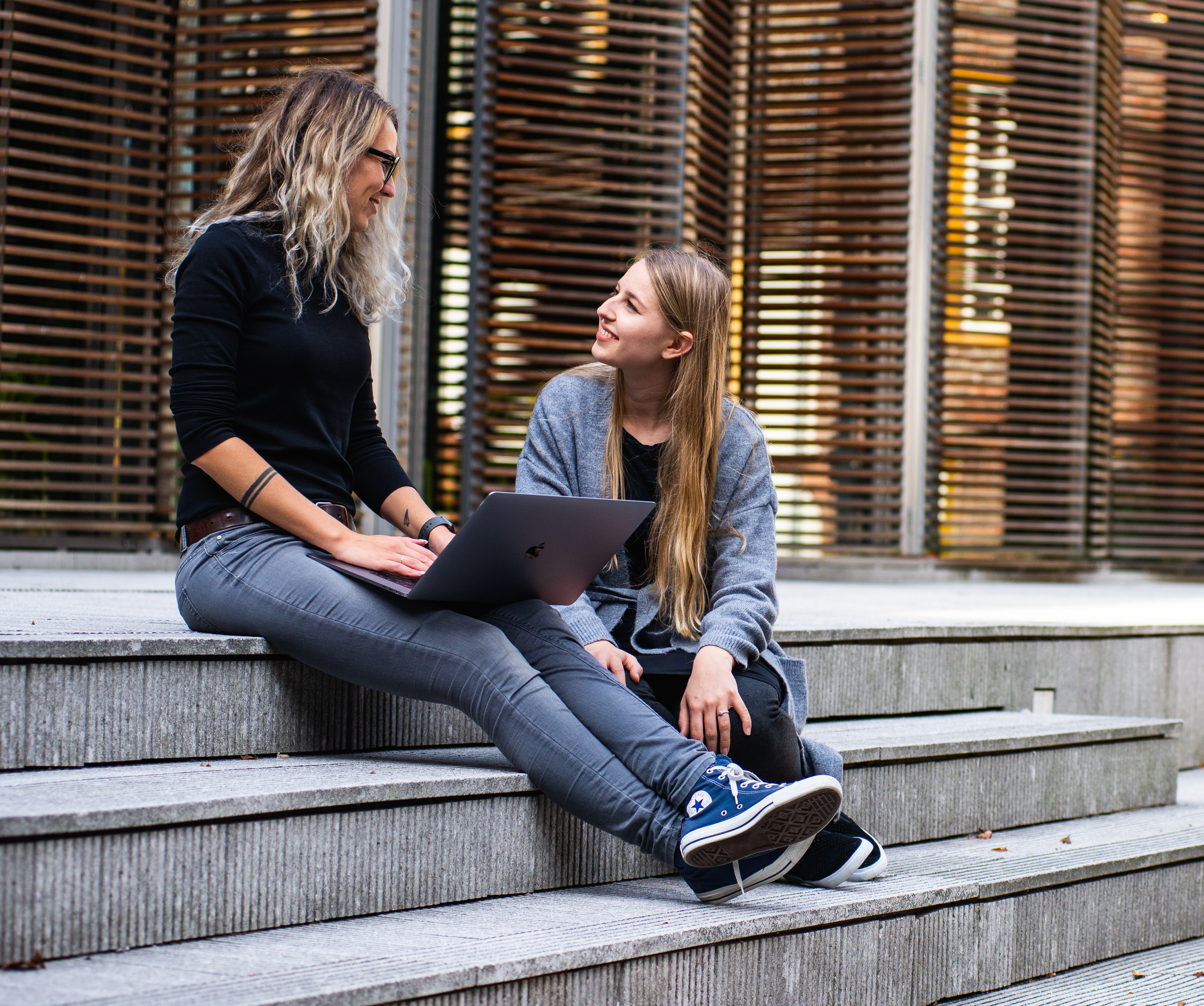 two-women-having-conversation-on-stairs-1438084_trimmed.jpg